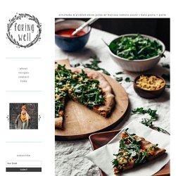Artichoke & Pickled Onion Pizza w/ Harissa Tomato Sauce + Kale Pesto + Parm