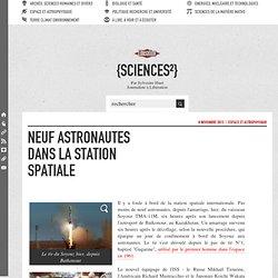 Neuf astronautes dans la station spatiale