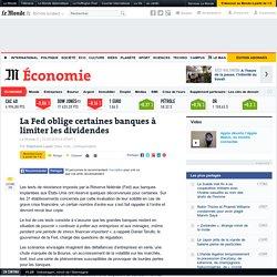 La Fed oblige certaines banques à limiter les dividendes - Le Monde 12/03/15