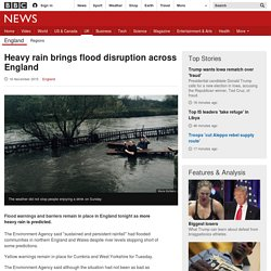 Heavy rain brings flood disruption across England