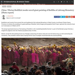 China: Tibetan Buddhist monks unveil giant painting of Buddha at Labrang Monastery [Photo report]