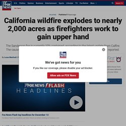 California wildfire explodes to nearly 2,000 acres as firefighters work to gain upper hand