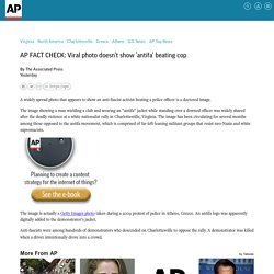 AP FACT CHECK: Viral photo doesn't show 'antifa' beating cop