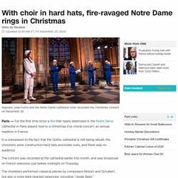 With choir in hard hats, fire-ravaged Notre Dame rings in Christmas