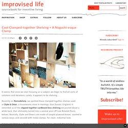 cool clamped-together shelving + a noguchi-esque clamp