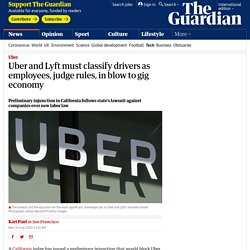 Uber and Lyft must classify drivers as employees, judge rules, in blow to gig economy