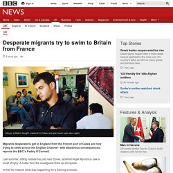 Desperate migrants try to swim to Britain from France - BBC News