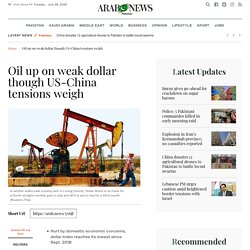 Oil up on weak dollar though US-China tensions weigh