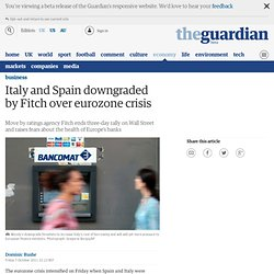 Italy and Spain downgraded by Fitch over eurozone crisis