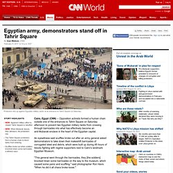 Activists block tanks from entering Tahrir Square