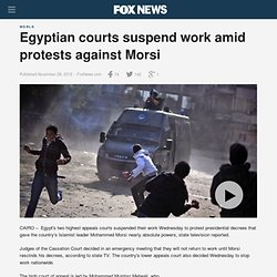 Egyptian courts suspend work amid protests against Morsi