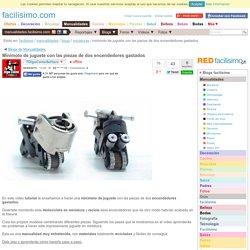 Minimoto de juguete con las piezas de dos encendedores gastados