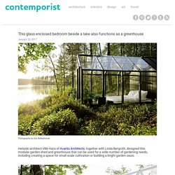 This glass enclosed bedroom beside a lake also functions as a greenhouse