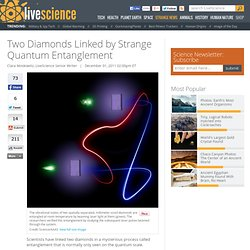 Two Diamonds Linked by Strange Quantum Entanglement