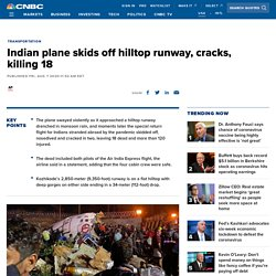 Air India Express plane skids off hilltop runway, cracks, killing 18
