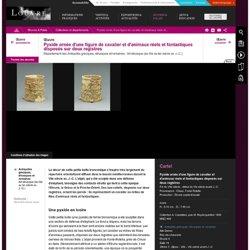 Pyxide ornée d'une figure de cavalier et d'animaux réels et fantastiques disposés sur deux registres
