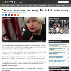Global economy worries prompt Fed to hold rates steady