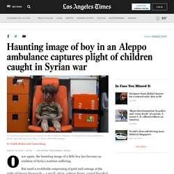 Haunting image of boy in an Aleppo ambulance captures plight of children caught in Syrian war