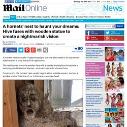 Hornets' nest fuses with wooden statue to become nightmarish visage