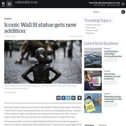 Iconic Wall St statue gets new addition