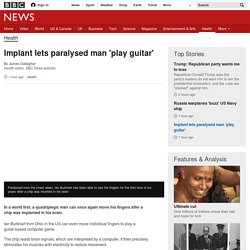 Implant lets paralysed man 'play guitar'
