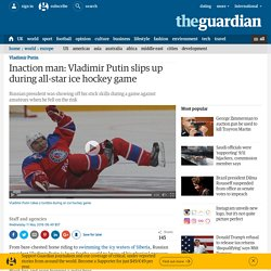 Inaction man: Vladimir Putin slips up during all-star ice hockey game