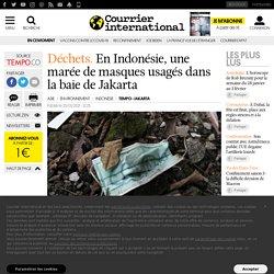 COURRIER INTERNATIONAL 25/01/21 Déchets.En Indonésie, une marée de masques usagés dans la baie de Jakarta