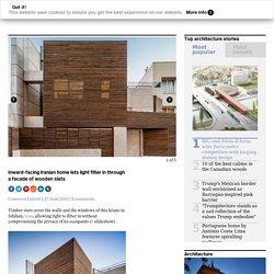 Inward-facing Iranian home lets light filter in through a facade of wooden slats