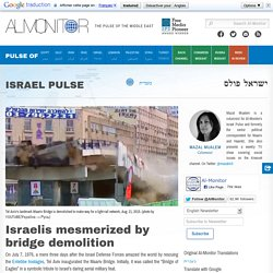 Israelis mesmerized by bridge demolition