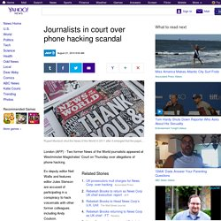 Journalists in court over phone hacking scandal