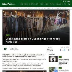 Locals hang coats on Dublin bridge for needy homeless