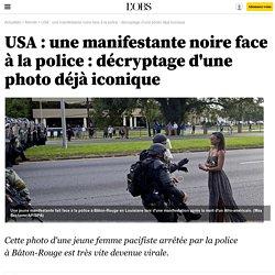 USA : une manifestante noire face à la police : décryptage d'une photo déjà iconique