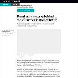 Rural army masses behind 'hero' farmer in homes battle