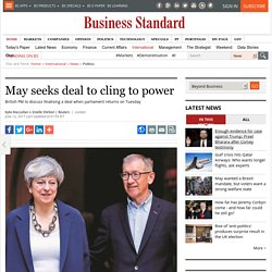 May seeks deal to cling to power
