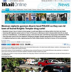 Mexican vigilante gunmen disarm local POLICE so they can rid town of feared Knights Templar drug cartel