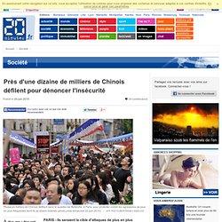 Près d'une dizaine de milliers de Chinois défilent pour dénoncer