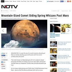 Mountain-Sized Comet Siding Spring Whizzes Past Mars