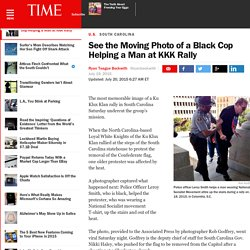 See the Moving Photo of a Black Cop Helping a Man at KKK Rally