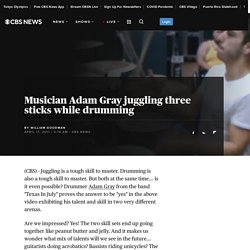 Musician Adam Gray juggling three sticks while drumming - The Feed