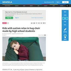Kids with autism relax in hug chair made by high school students