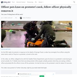 Officer Puts Knee on Protester's Neck, Fellow Officer Removes It