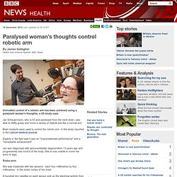 Paralysed woman's thoughts control robotic arm