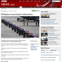 Philippine mourning for slain police