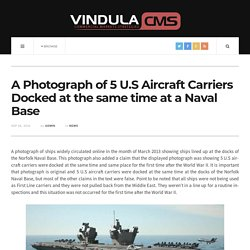A Photograph of 5 U.S Aircraft Carriers Docked at the same time at a Naval Base