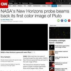 NASA probe beams back its first color image of Pluto