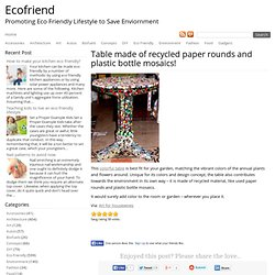 Table made of recycled paper rounds and plastic bottle mosaics!