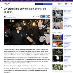 LA protesters defy eviction efforts, go to court