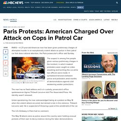 Paris Protests: American Charged Over Attack on Cops in Patrol Car