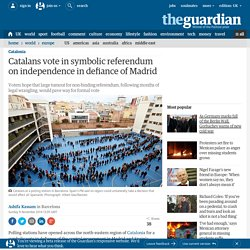 Catalans vote in symbolic referendum on independence in defiance of Madrid