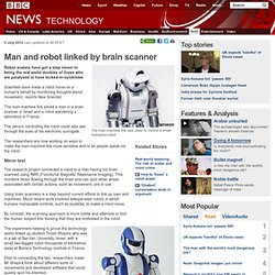 Man and robot linked by brain scanner